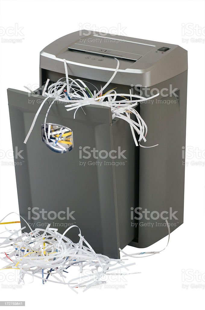 Overflowing paper shredder meaning identity theft prevention stock photo