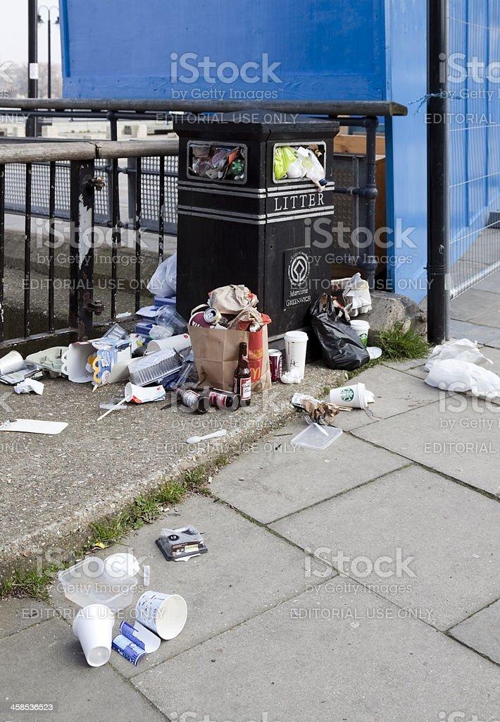 Overflowing rubbish bin at Greenwich royalty-free stock photo
