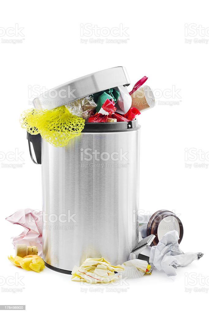 Overflowing stainless steel trash can stock photo