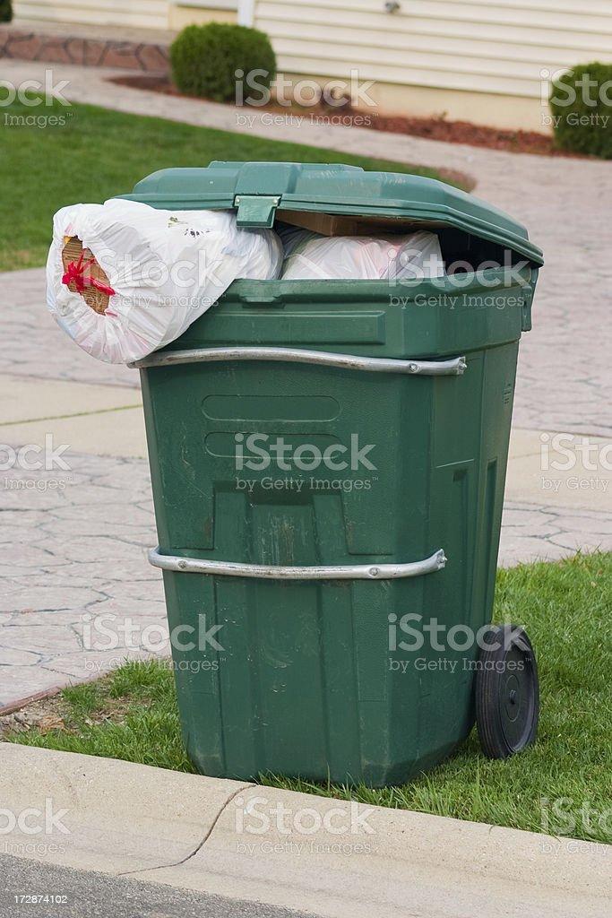 overflowing trash bin royalty-free stock photo