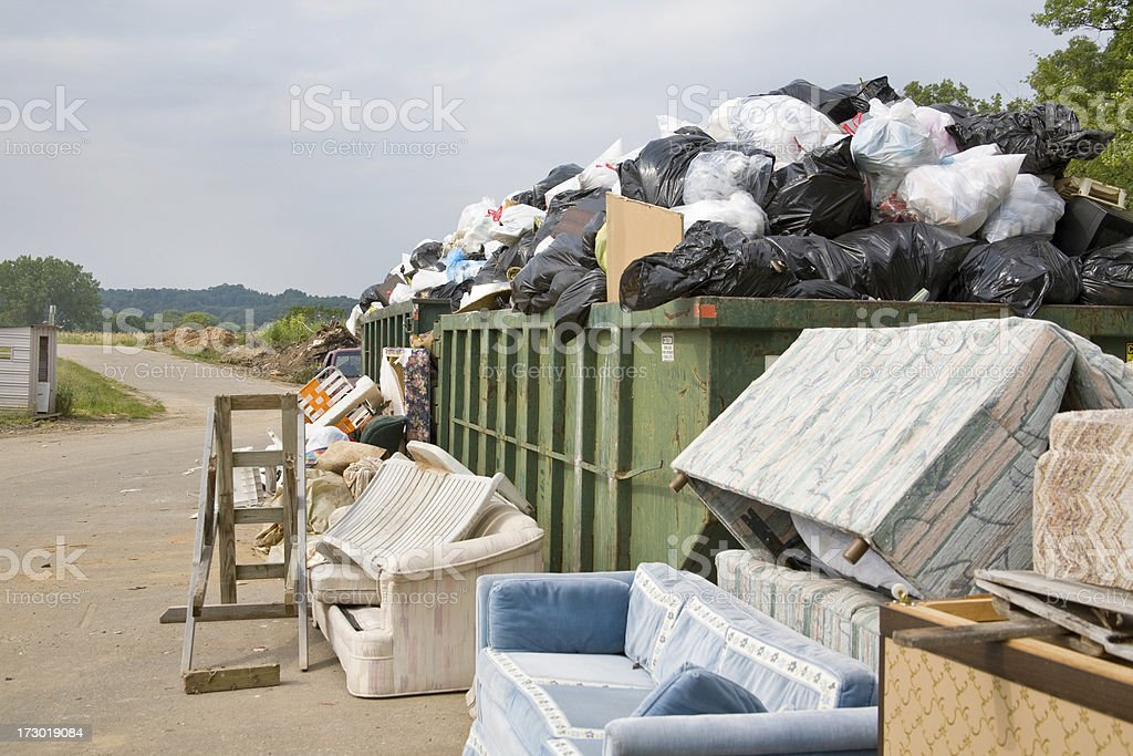 overflowing trash dumpster iii royalty-free stock photo
