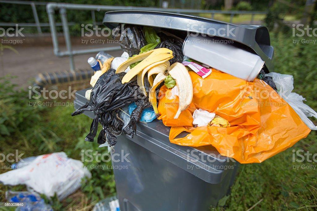 Overflowing trash/rubbish bin stock photo