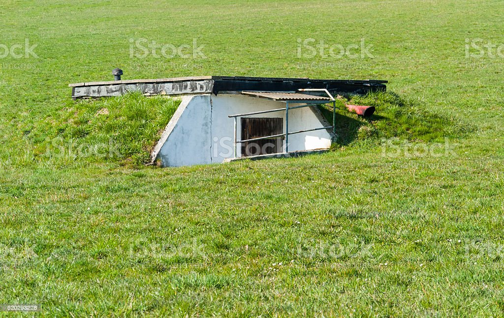 overgrown bunker stock photo