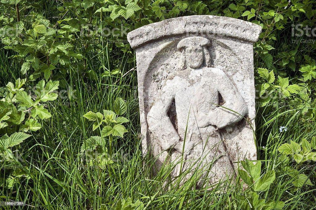 Overgrown old symbolic gravestone, Scottish Borders, UK stock photo
