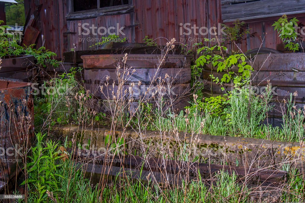 Overgrown railroad ties and wheels stock photo