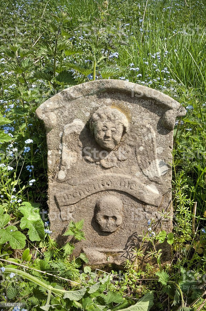Overgrown symbolic gravestone, Scottish Borders, UK stock photo