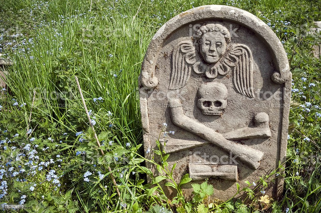 Overgrown symbolic old gravestone, Scottish Borders, UK stock photo