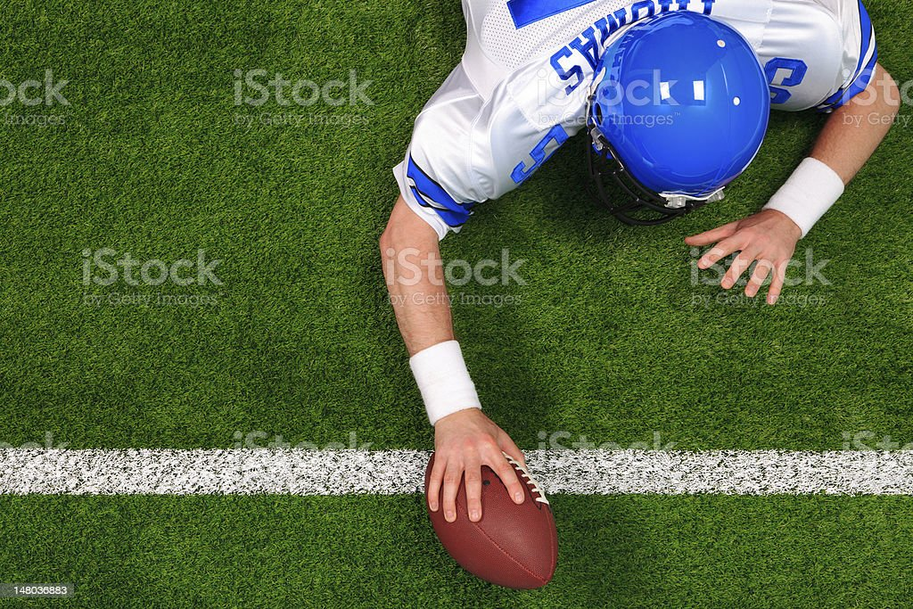 Overhead American football player one handed touchdown stock photo