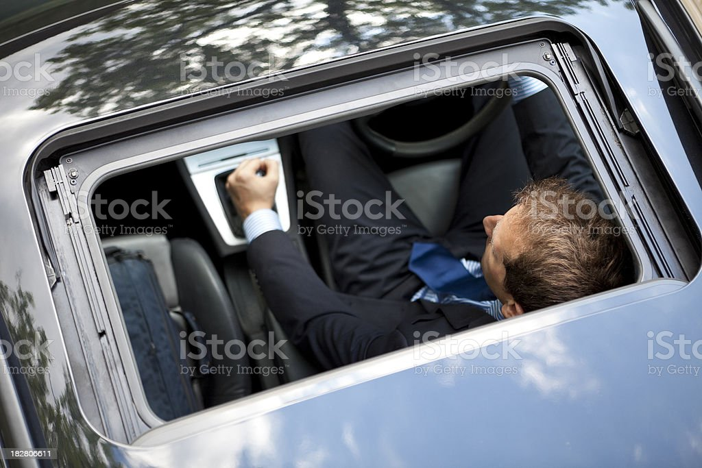 Overhead Businessman Driving Car - Moving Up A Gear royalty-free stock photo