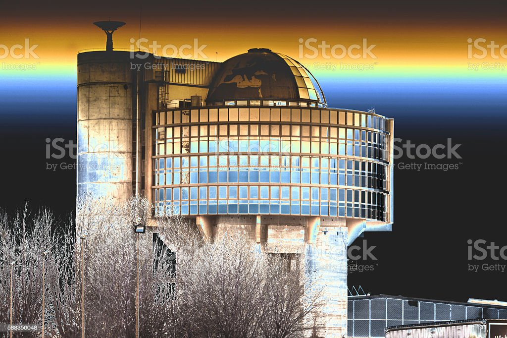 Overhead hopper with modern architectural building dome. stock photo