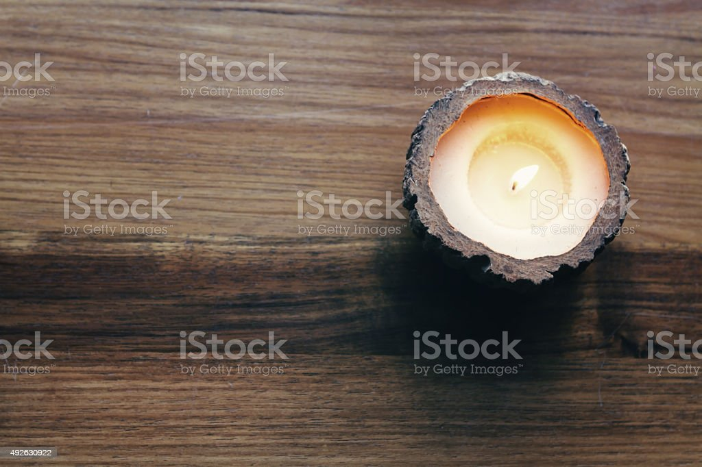 Overhead of a burning decorative candle stock photo
