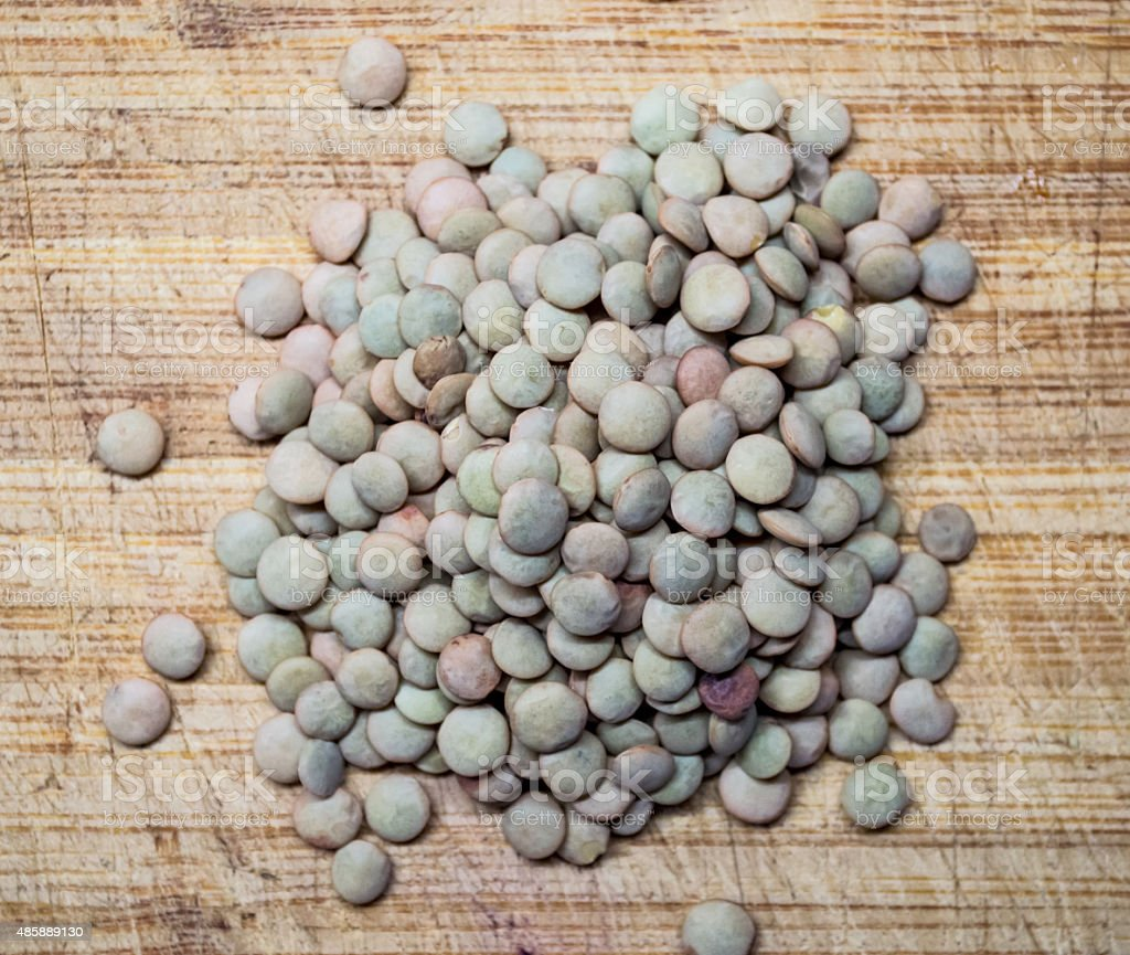 Overhead of Brown and Green Lentils on a Wooden Board royalty-free stock photo