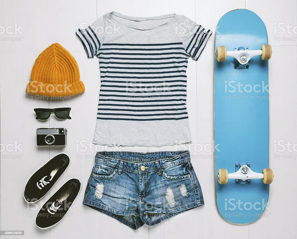 Overhead of essentials skater woman. stock photo