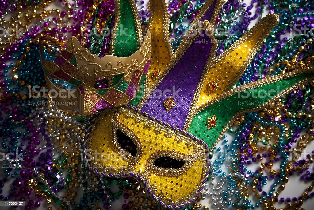 Overhead of Mardi Gras mask and beads stock photo