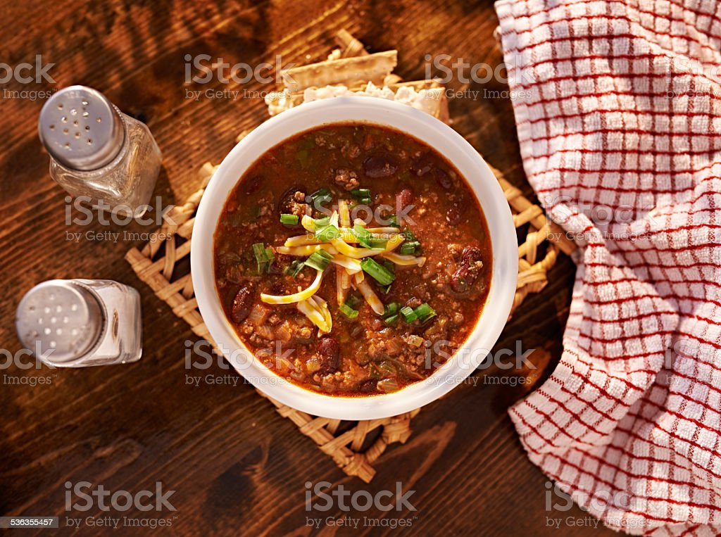 overhead photo of a bowl of chili stock photo