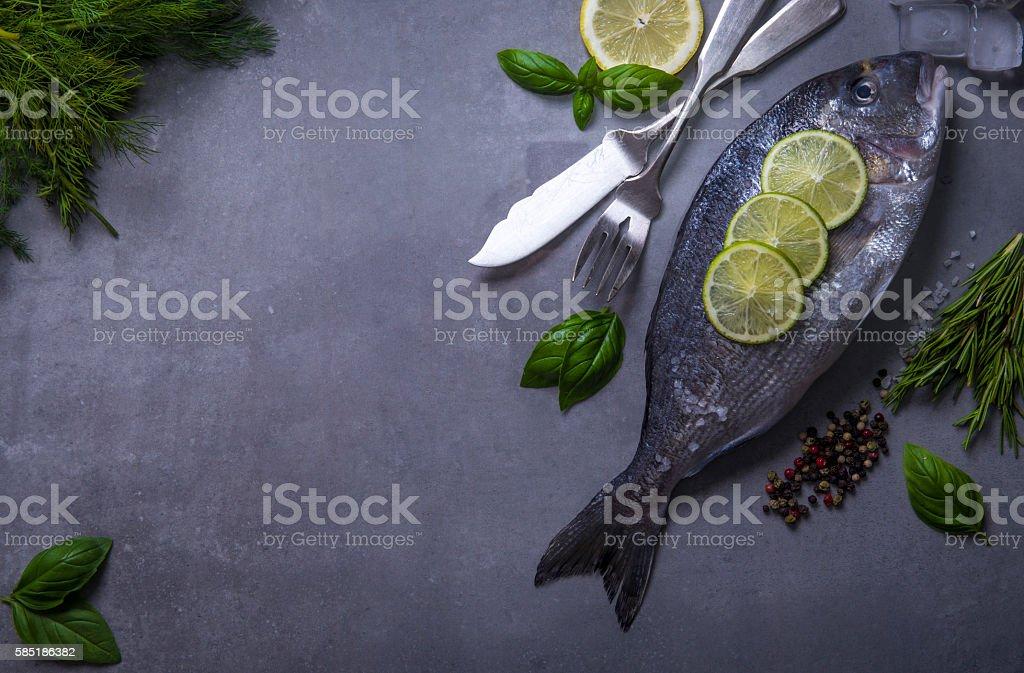 Overhead photo of sea bream fish with seasonings stock photo