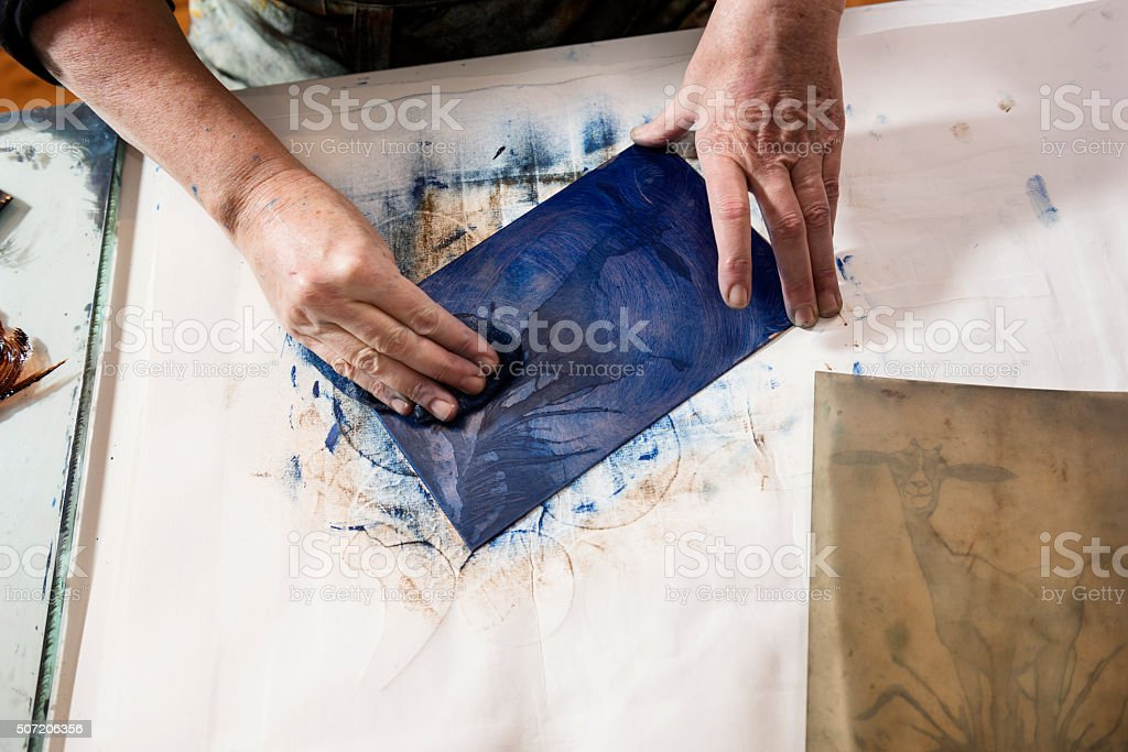 Overhead Portrait of a Printmaker Artist At Work stock photo