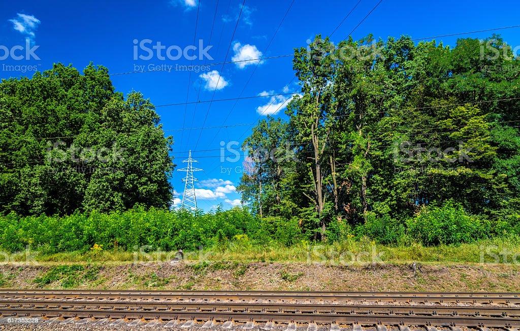 Overhead power lines above a railway in Ukraine stock photo