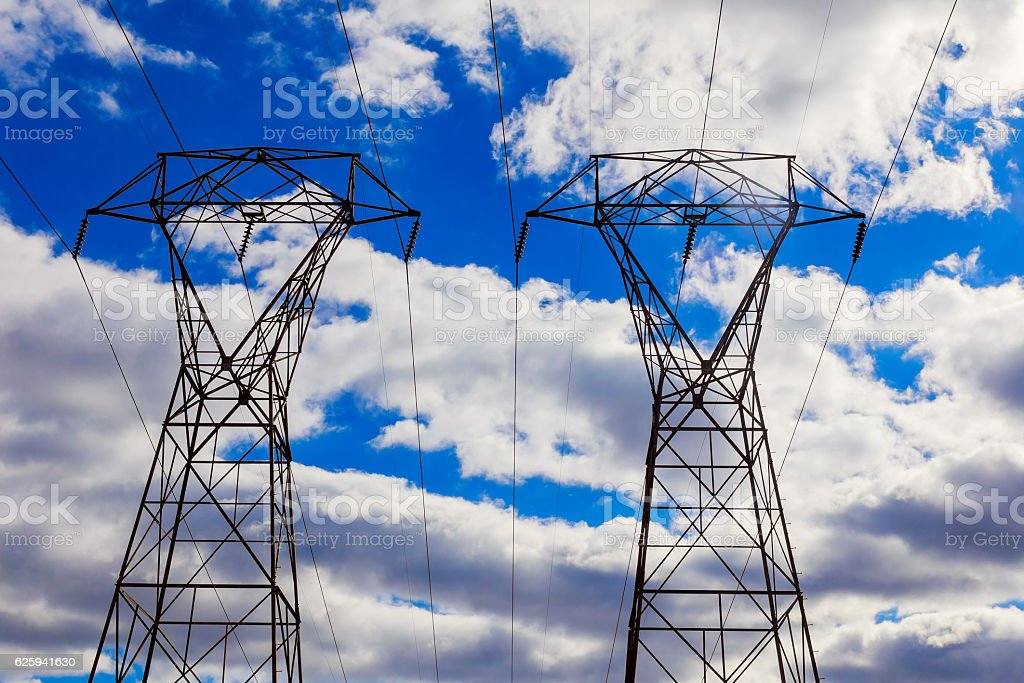 overhead power lines in a cloudy winter sky stock photo