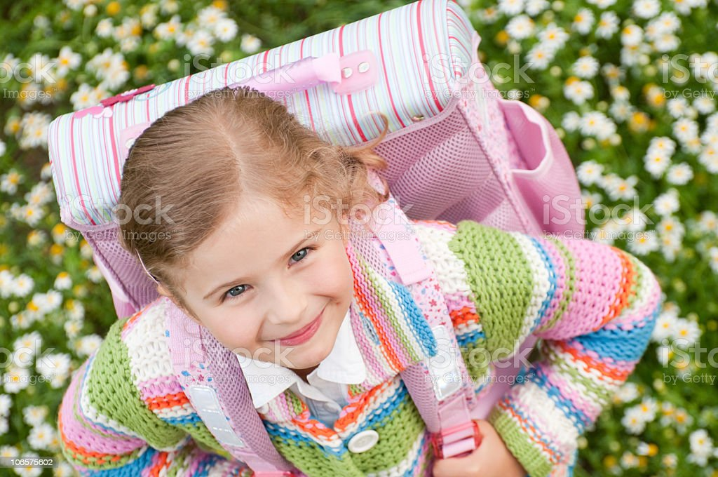 Overhead shot of a girl with her backpack ready for school stock photo