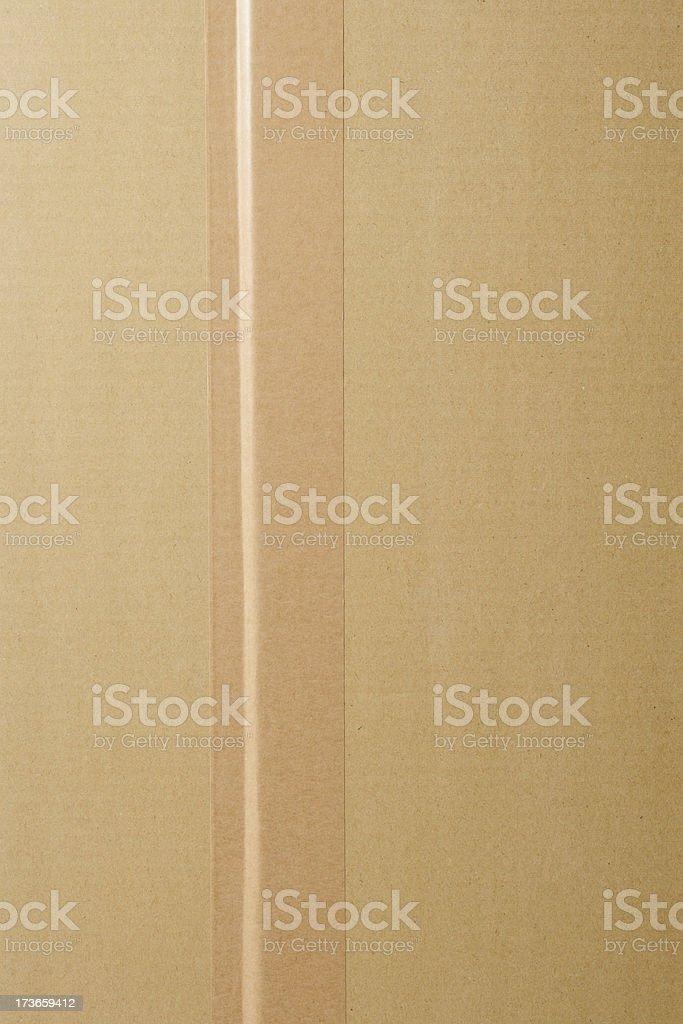 Overhead shot of cardboard box with adhesive tape stock photo