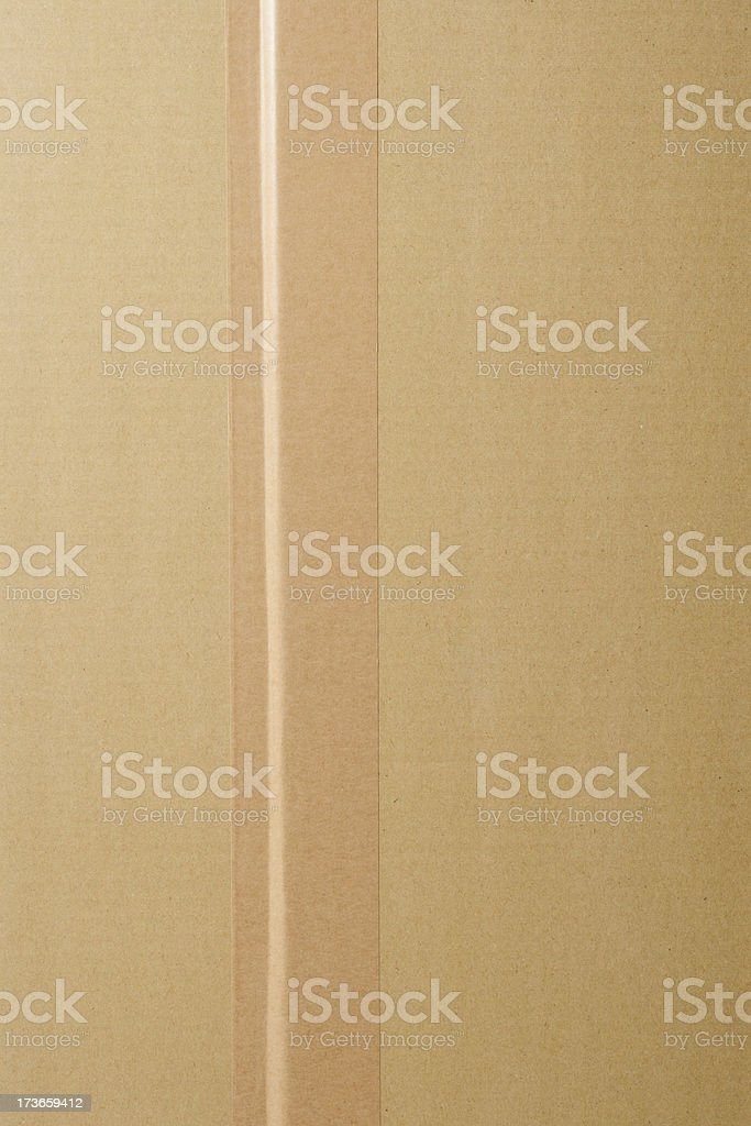 Overhead shot of cardboard box with adhesive tape stock photo