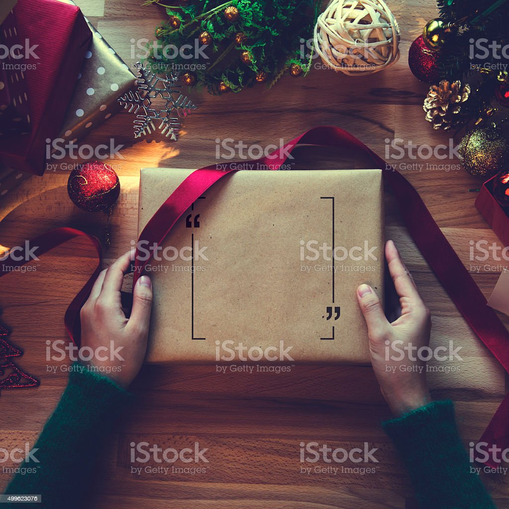 Overhead shot of Christmas presents and wrapping papers stock photo