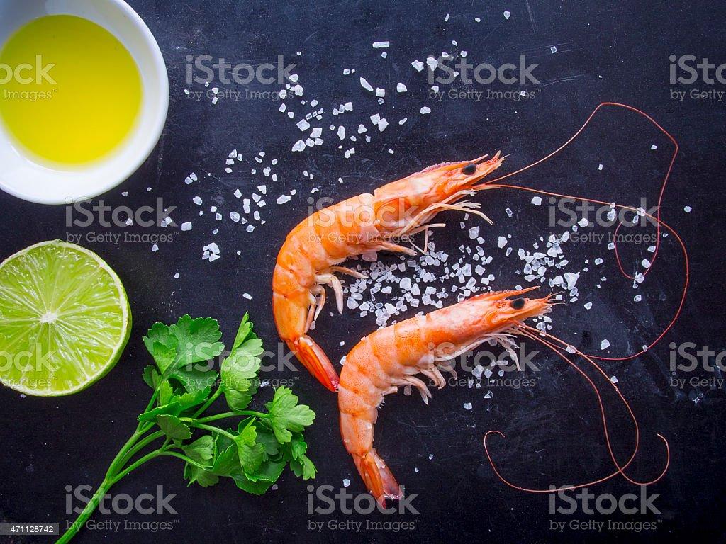 Overhead shot of fresh shrimps on dark background stock photo