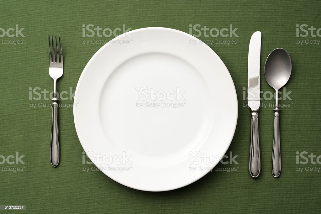 Overhead shot of place setting on green tablecloth stock photo