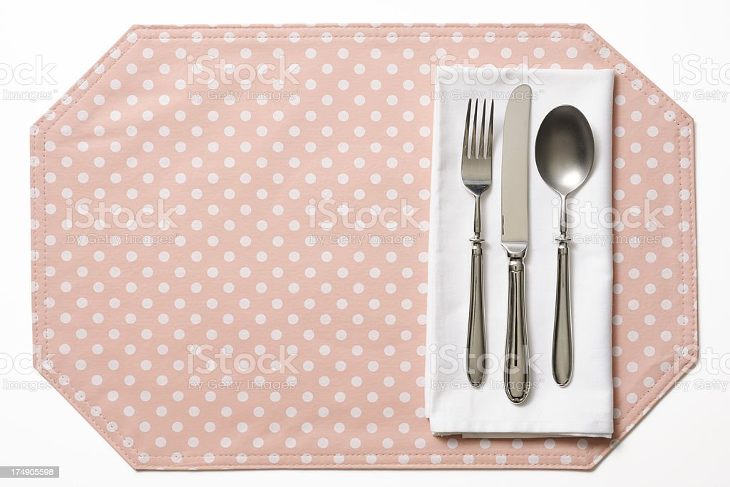 Overhead shot of place setting on pink place mat royalty-free stock photo
