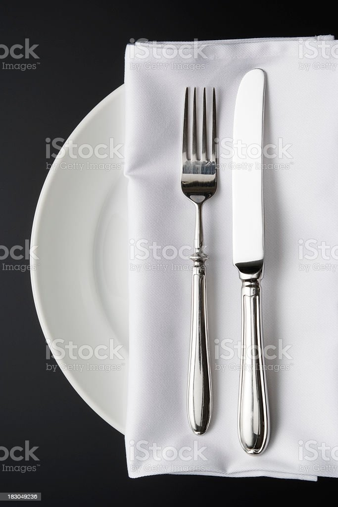 Overhead shot of place setting on the black background stock photo