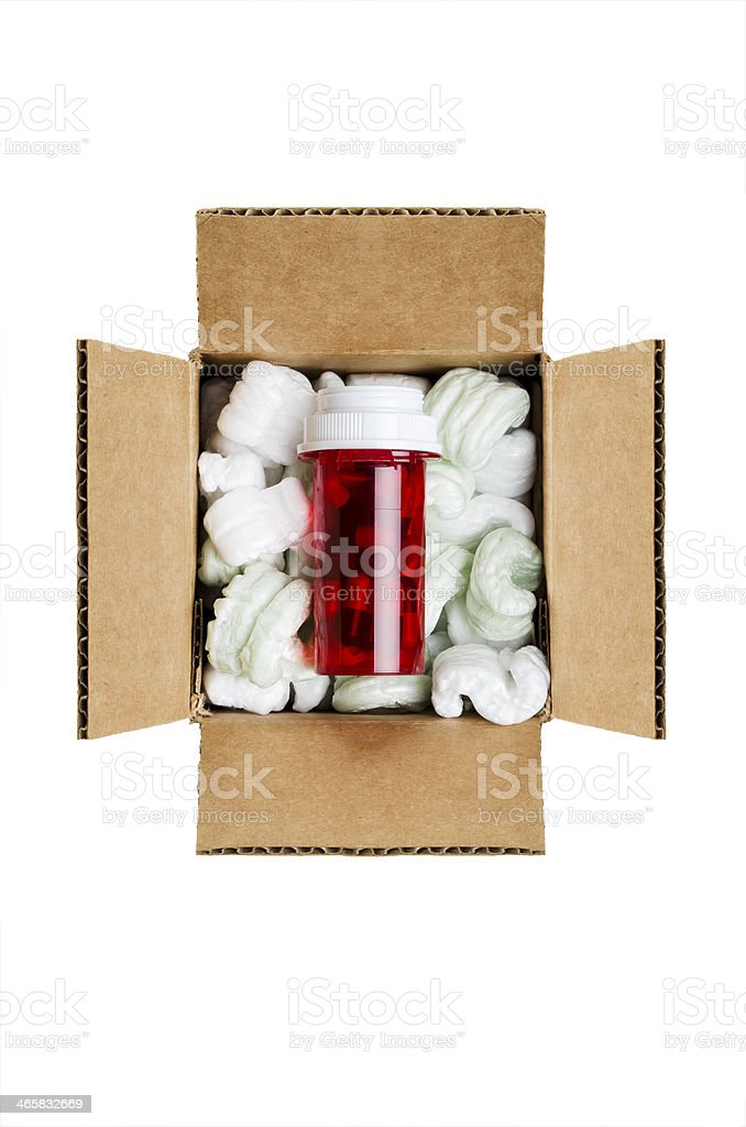 Overhead shot of red vial of medicine inside a packaged box stock photo
