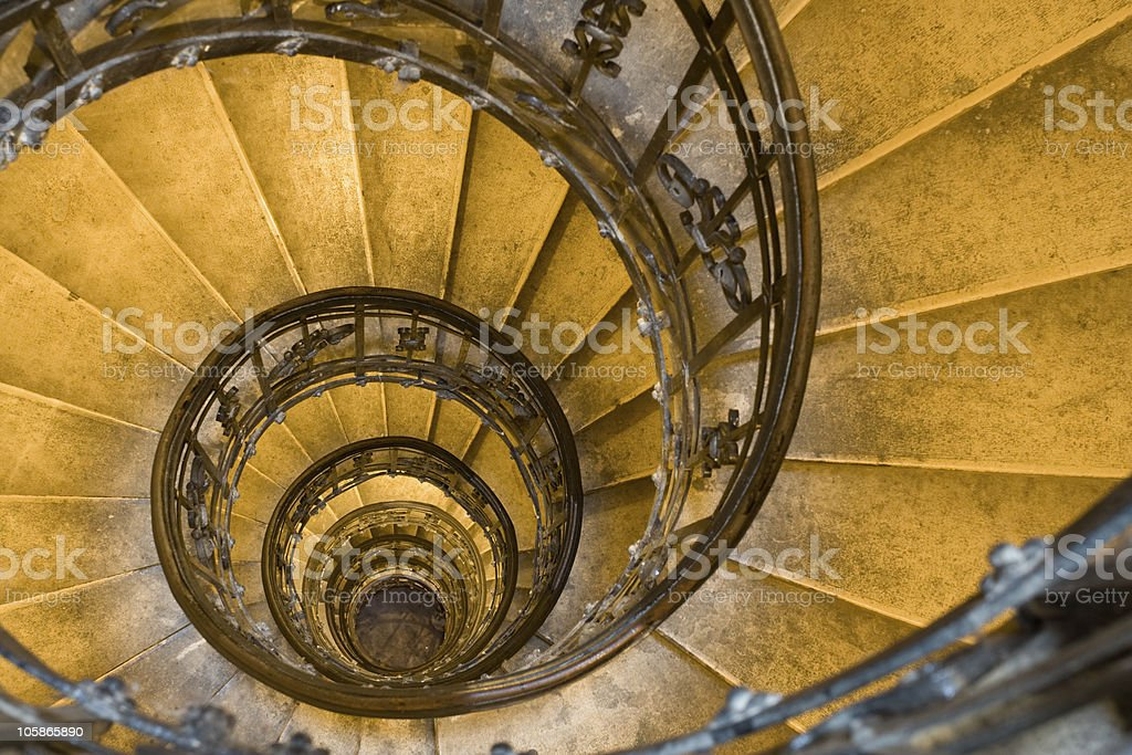 Overhead shot of spiral staircase with wrought iron railings stock photo