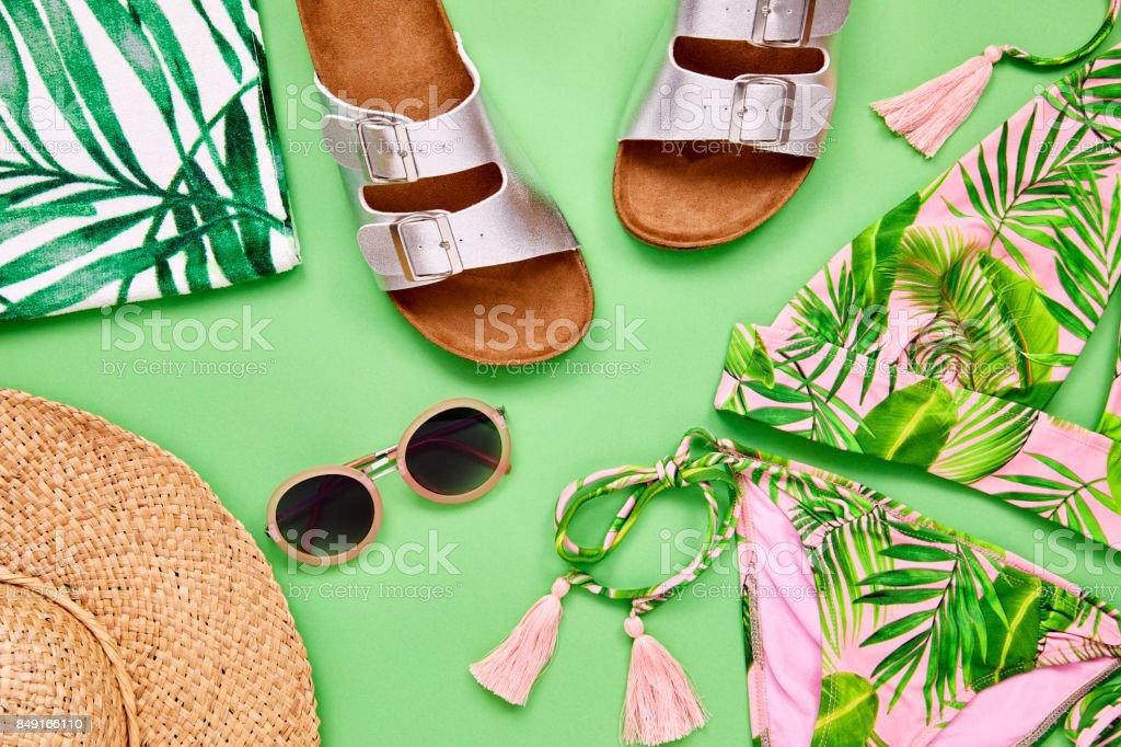 Flat lay shot of summer vacation accessories. Overhead shot of bikini...