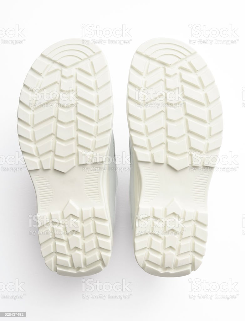 Overhead shot of white shoe sole on white background stock photo