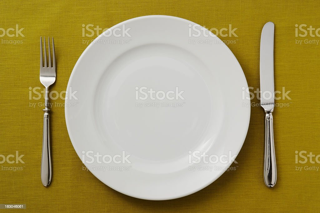Overhead shot off place setting on green tablecloth royalty-free stock photo