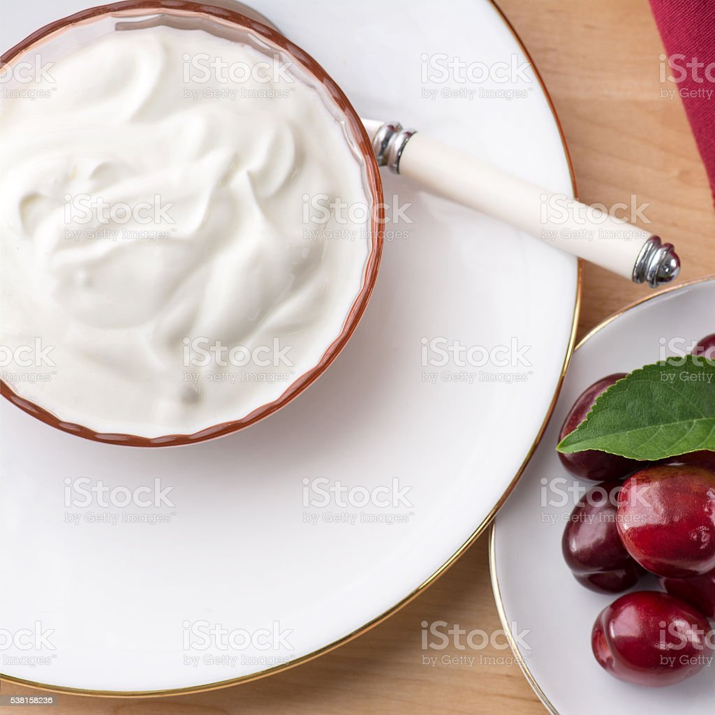 Overhead Square view of thick creamy natural greek yoghurt stock photo