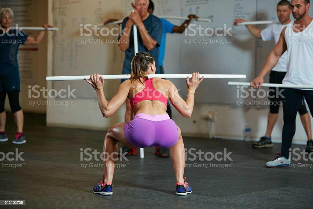 Overhead squats develop mobility and flexibility stock photo