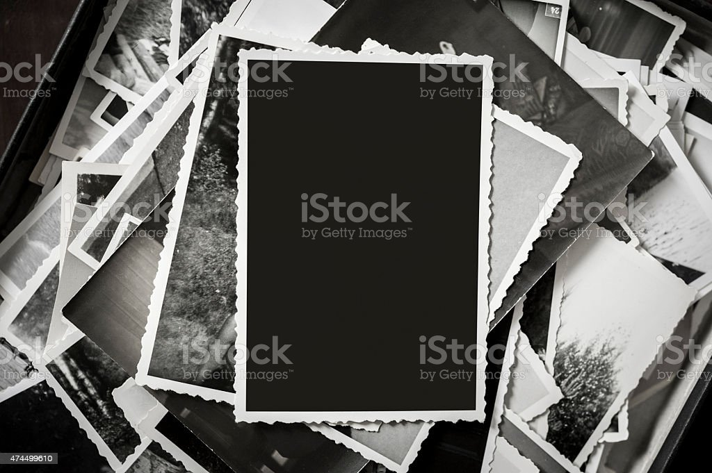 Overhead view of a box with vintage family photos stock photo