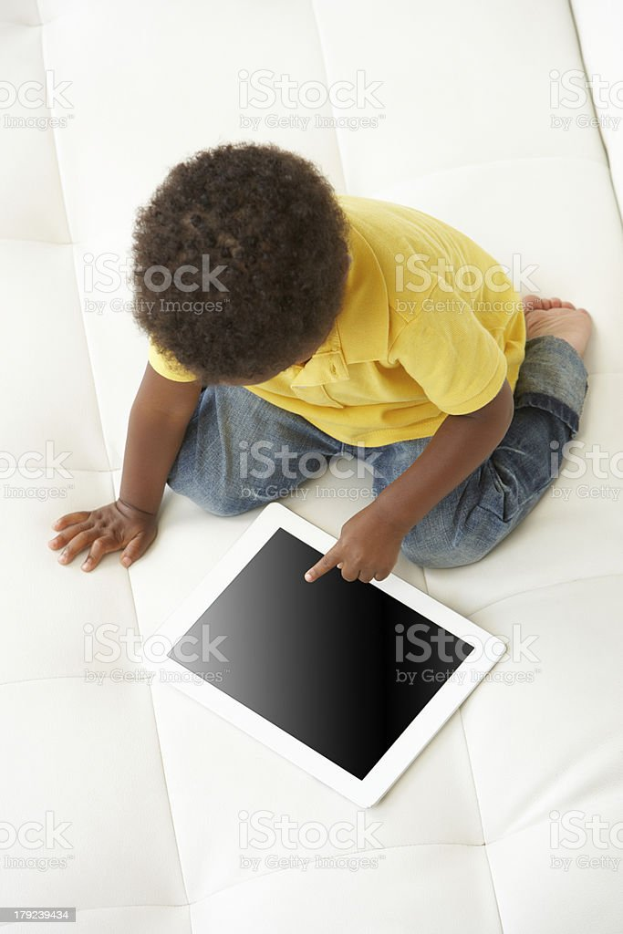 Overhead view of a boy on a tablet PC royalty-free stock photo
