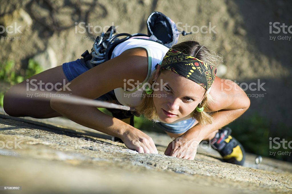Overhead view of a female wall climber in action royalty-free stock photo