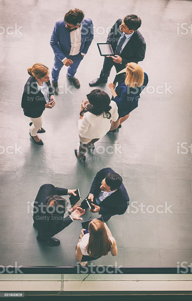 Overhead view of a group of business people stock photo