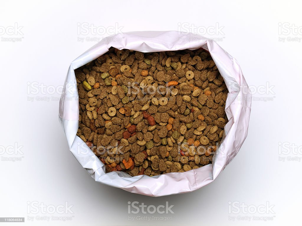 Overhead view of a large bag of dry pet food on white back stock photo