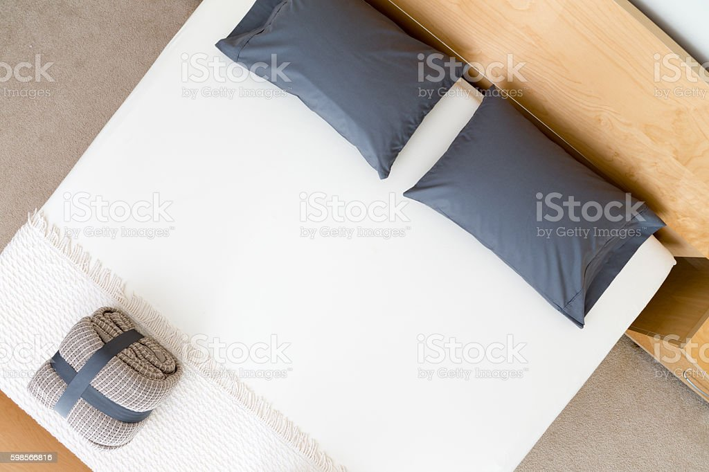 Overhead view of a neat king size bed stock photo