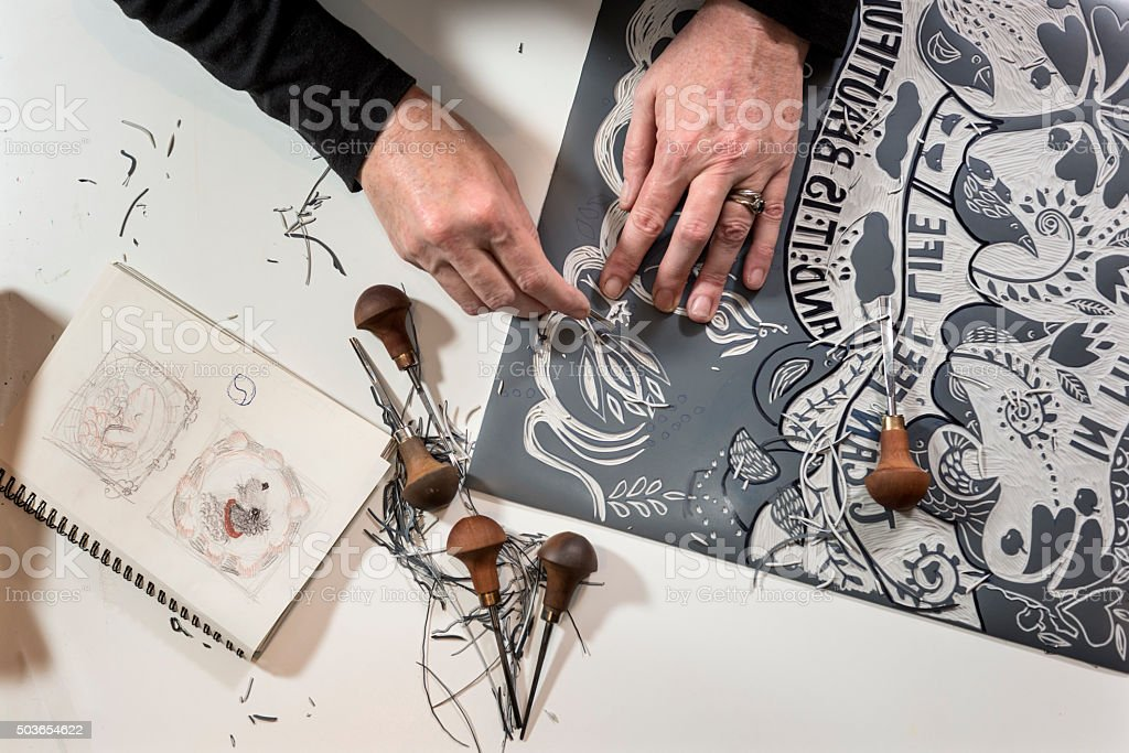Overhead View of a Printmaker Artist At Work stock photo