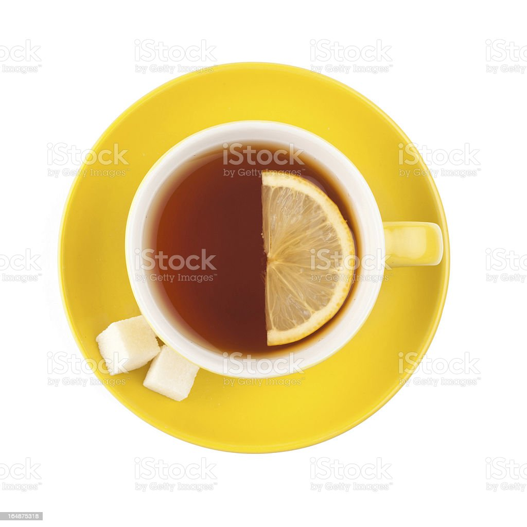 Overhead view of a teacup with sugar and a slice of lemon royalty-free stock photo