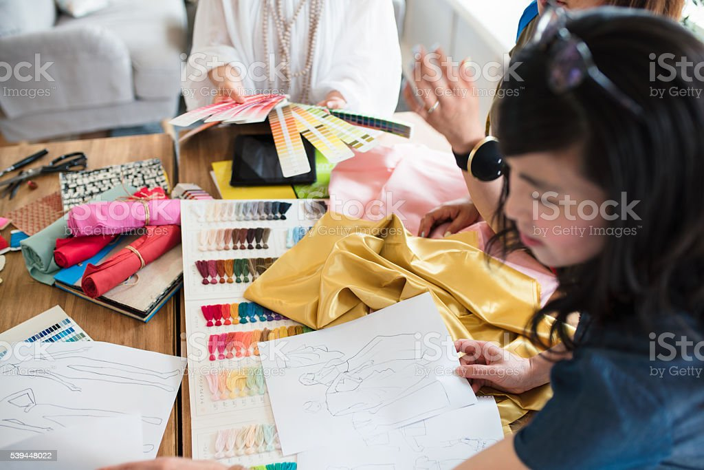 Overhead view of a team of fashion designers working stock photo