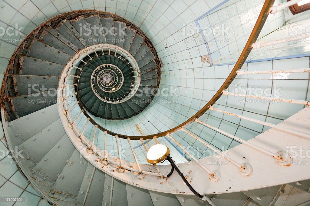 Overhead view of a very high curled lighthouse stairs stock photo