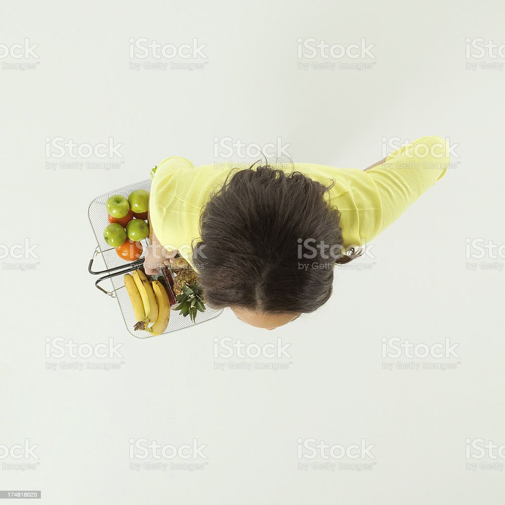 Overhead view of a woman with grocery basket royalty-free stock photo