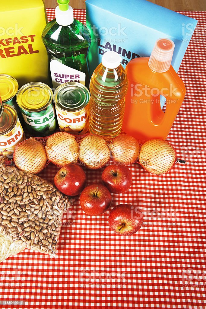Overhead view of basic foods and cleaning products royalty-free stock photo